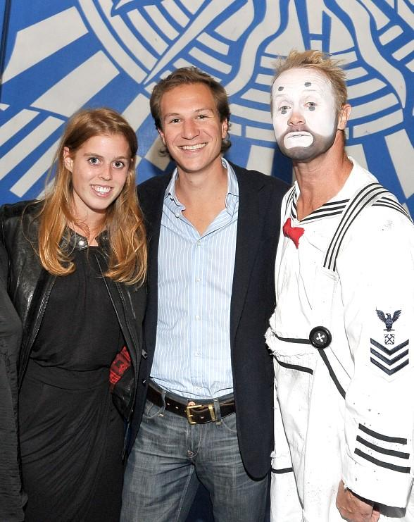 "Princess Beatrice and David Clark with ""O"" performer"