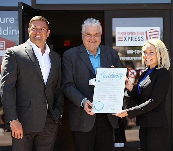 Clark County Commissioner, Steve Sisolak, presents the Proclamation