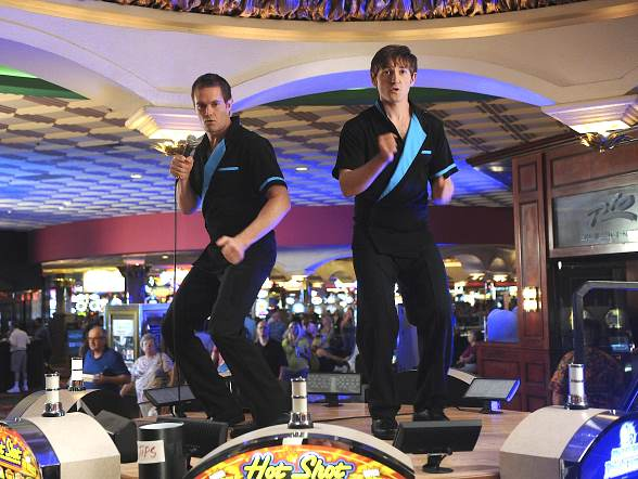 """In an attempt to raise money for a wedding, Lucas Neff (right) and Garret Dillahunt (left) pretend to work as beverage-serving entertainers at the Rio All-Suite Hotel & Casino in Las Vegas in the """"Henderson, Nevada-Adjacent, Baby! Henderson, Nevada-Adjacent!"""" episode of """"Raising Hope."""" The popular sitcom will air Tuesday, October 4 at 9:30PM ET/PT on FOX. Don't miss it!"""