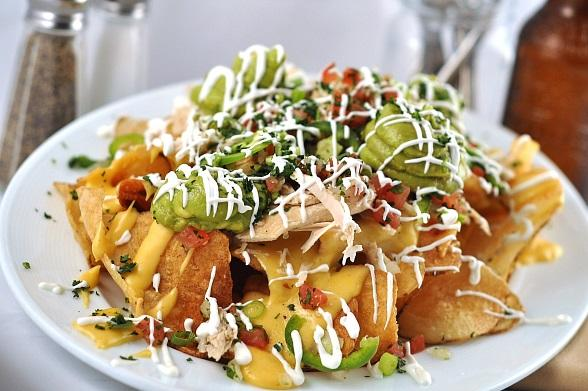 Ranch House Kitchen's BBQ Potato Chip Nachos with pico de gallo, jalapeños, guacamole, sour cream and chicken