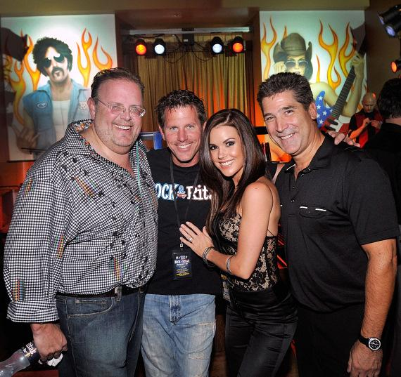 "Owners David Tuttleman and Mark Green pictured with iconic rockers ""Rock"" and ""Rita."""