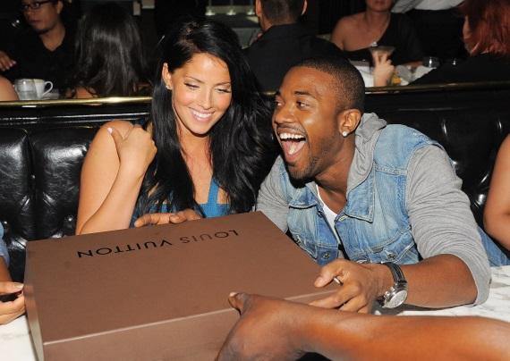 Ray J gifting Alvarez with a limited edition Louis Vuitton handbag