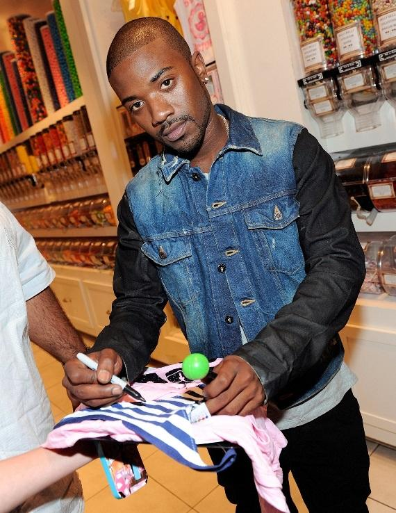 Ray J autographing Sugar Factory apparel