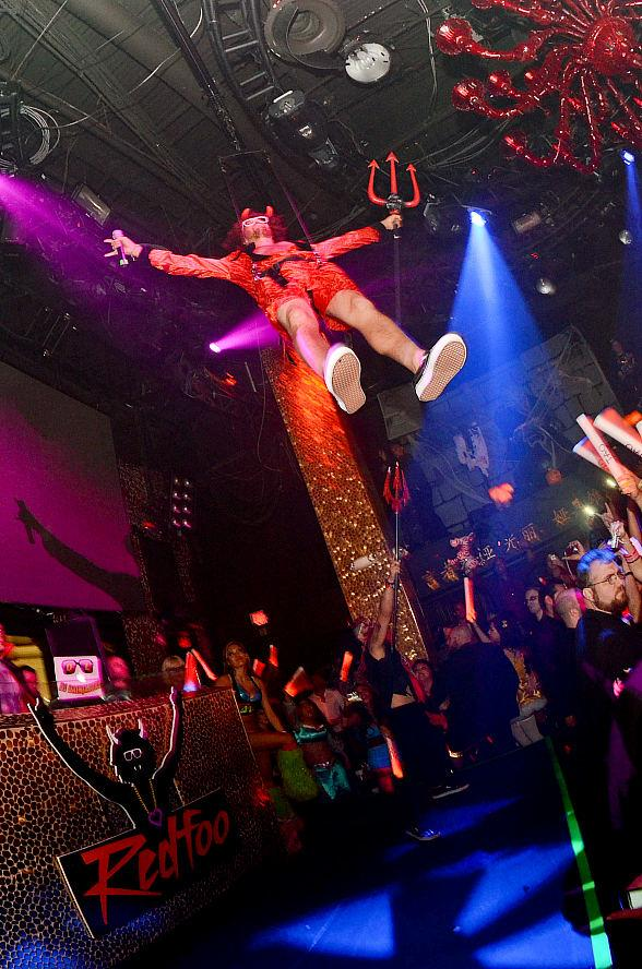 Redfoo flies into TAO on a zipline