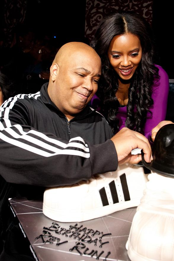 Rev Run with daughter Angela Simmons and birthday cake at TAO
