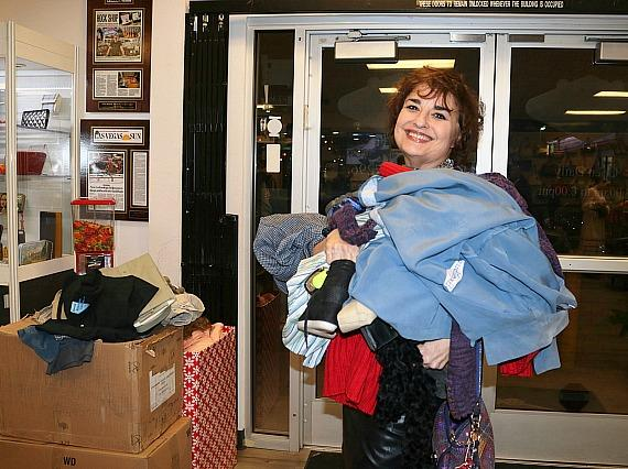A Max Pawn customer donates winter items to Nevada Partnership for Homeless Youth at Las Vegas Fashion Council's recent Bags & Bubbles event at Max Pawn. Donations will be accepted through Dec. 20.