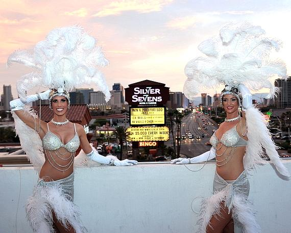 Silver Sevens Hotel & Casino showgirls posing with the new marquee sign after the official lighting ceremony