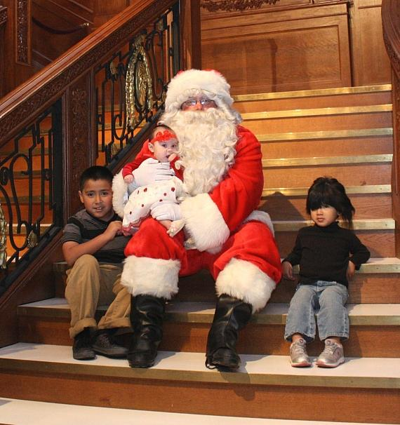 Santa on Titanic staircase with kids