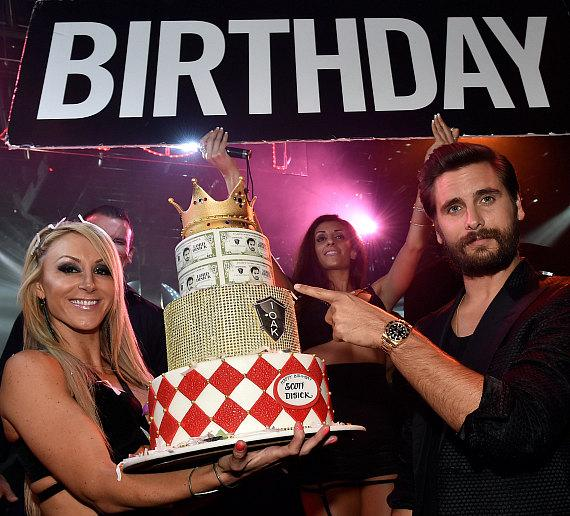 Scott Disick with cake at 1 OAK