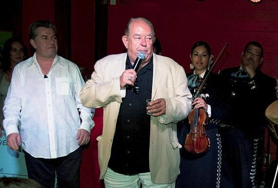 Robin Leach toasts at Senor Frog's