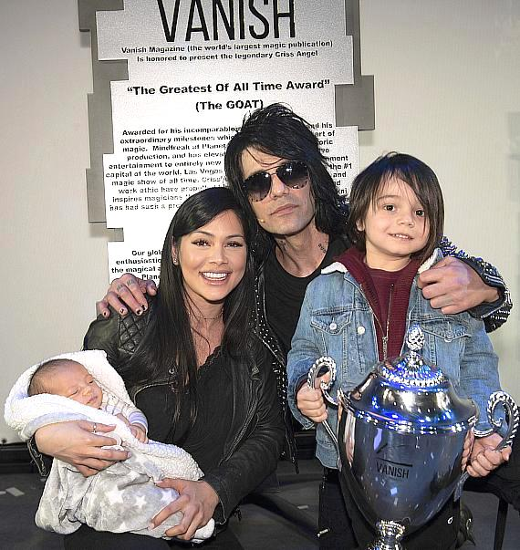 Shaunyl Benson (L) and Criss Angel (R) celebrate the VANISH G.O.A.T. Award with their sons, Feb. 22