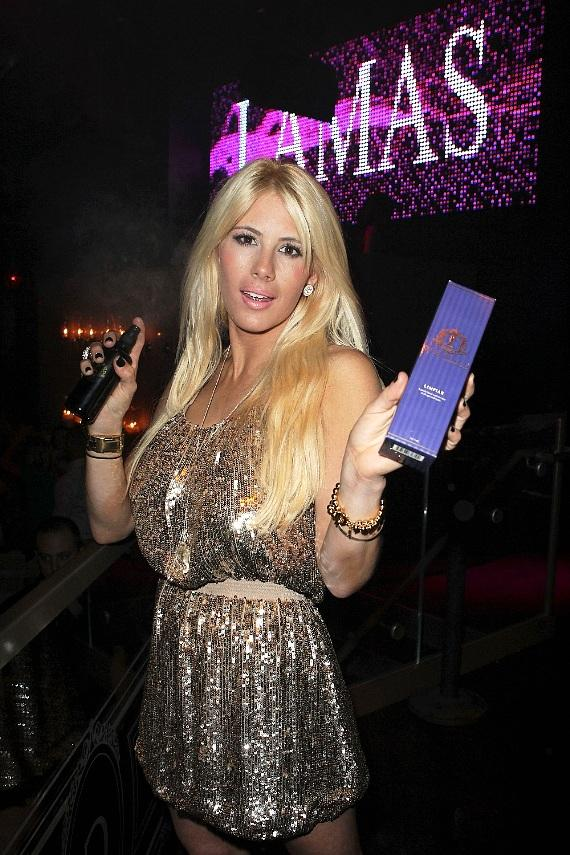 Shayne Lamas with her Lamas Organics skincare line at VIP table at Chateau Nightclub & Gardens