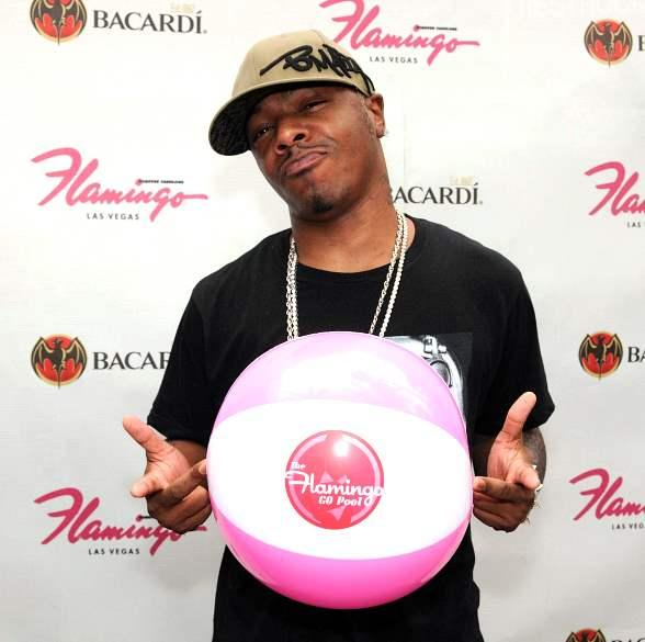 SisQó at the GO Pool with Flamingo beach ball