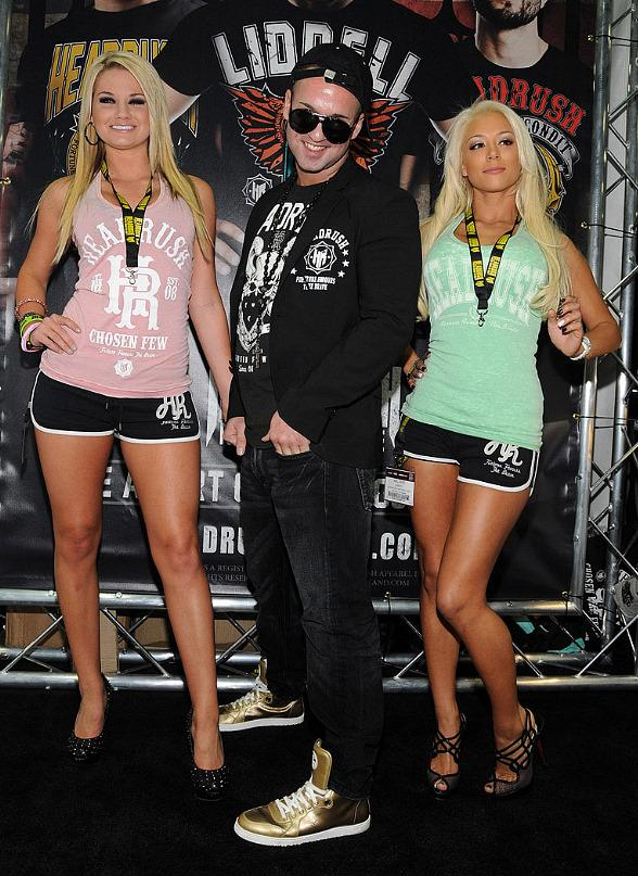 Jersey Shore's Mike 'The Situation' Sorrentino with model at Headrush Booth at MAGIC
