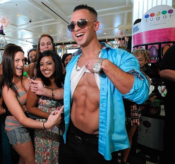 The Situation showing off his ab-tastic situation at Sugar Factory in Las Vegas