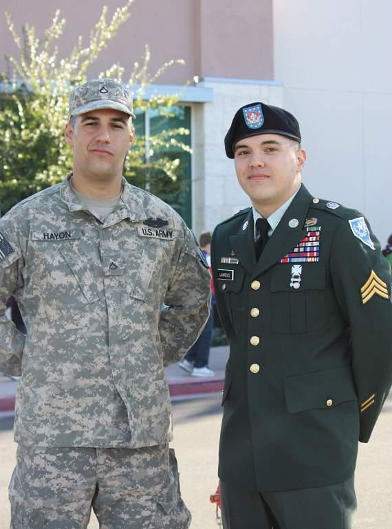 Local US Army PFC Gil Hayon, of the 25th ID and Sergeant Army National Guard Brett Lawrence pose after greeting the entire student body of the Adelson Educational Campus during a Veteran's Day celebration.