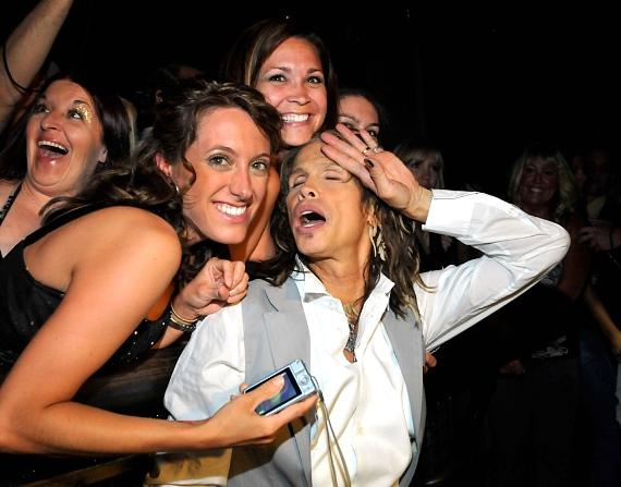 Steven Tyler poses with fans