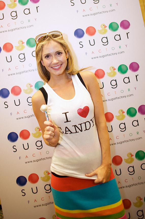"""Ashley Jones with a Sugar Factory Couture Pop and """"I Love Candy"""" tank top."""