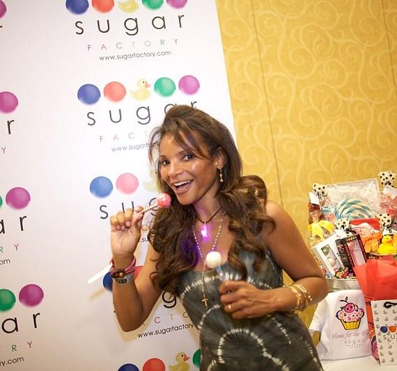Dr. Lisa Masterson with a Sugar Factory Couture Pop