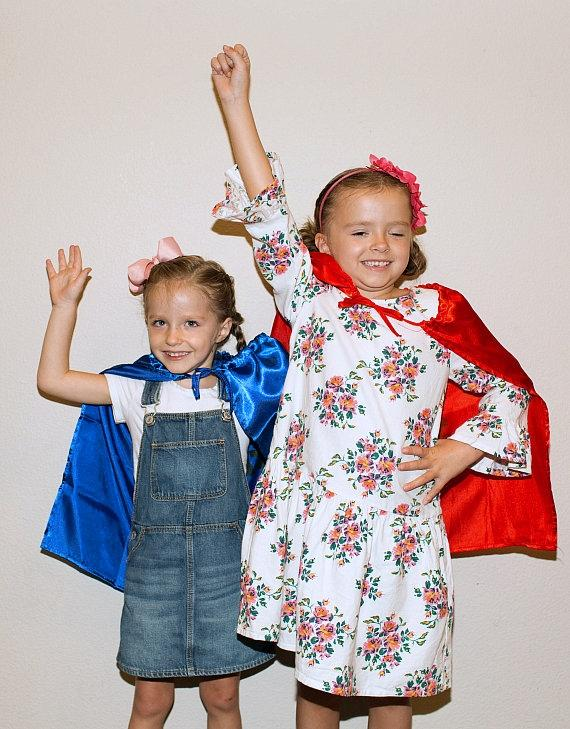 Superhero Ambassador Navy Bishop, 6, (right) and her younger sister Riley in their Superhero capes