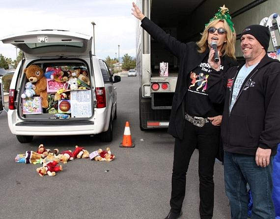 Susan Anton of Menopause the Musical with van at KLUC Toy Drive
