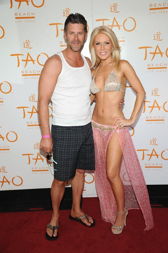 Slade and Gretchen Christine Rossi on red carpet at TAO Beach