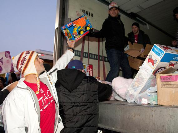 TAO's Bob Shindelar loads toys on truck