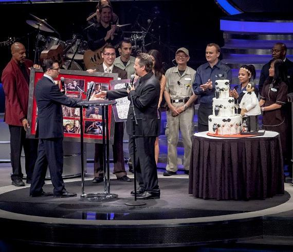 Vice President of Hotel Operations Franz Kallao congratulates Terry Fator on three successful years