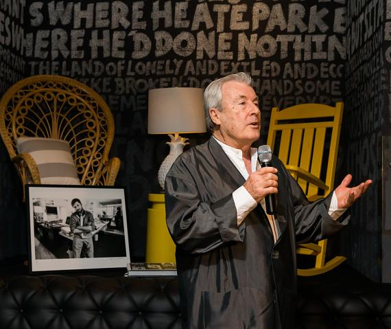 Terry O'Neill making a speech at the Iconic Images Gallery after-party inside Foxtail