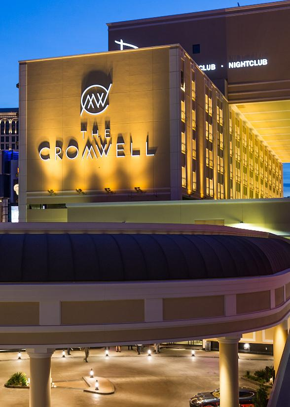 The Cromwell sign illuminates on the side of the building as guests received their first glimpse of the standalone boutique hotel.