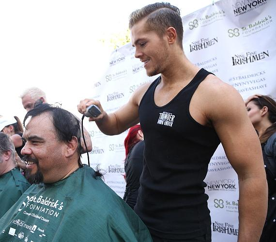 Thunder From Down Under cast member tries his hand at head-shaving at New York-New York's 6th annual St. Baldrick's Day