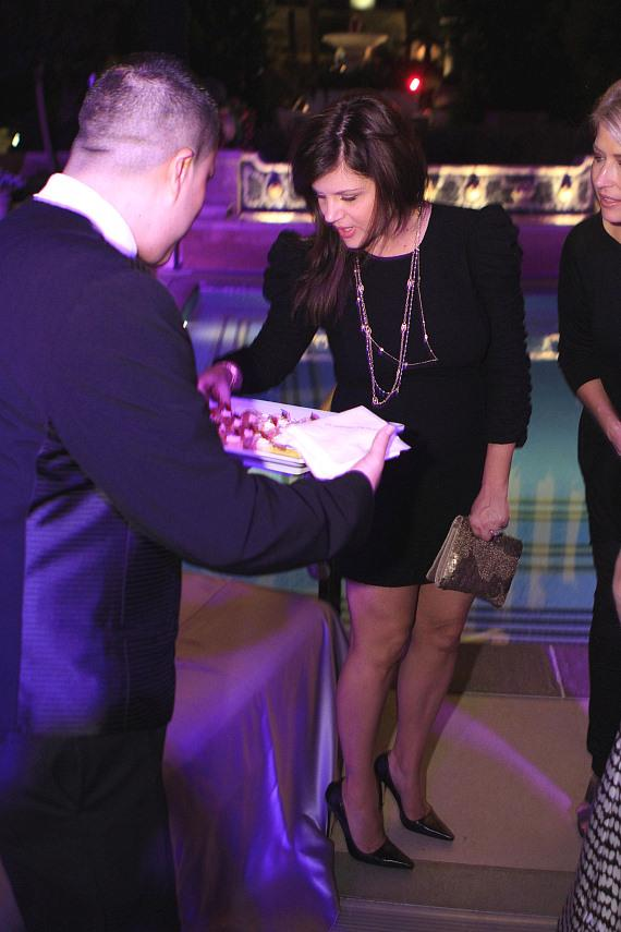 Tiffani Thiessen selecting food from a server's tray