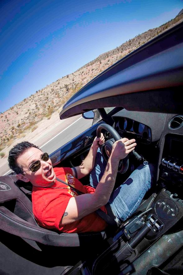 Travis Cloer driving a Ferrari 458 through Red Rock Canyon
