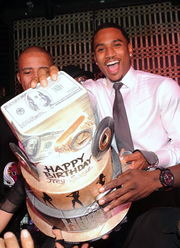 Trey Songz with cake at LAVO
