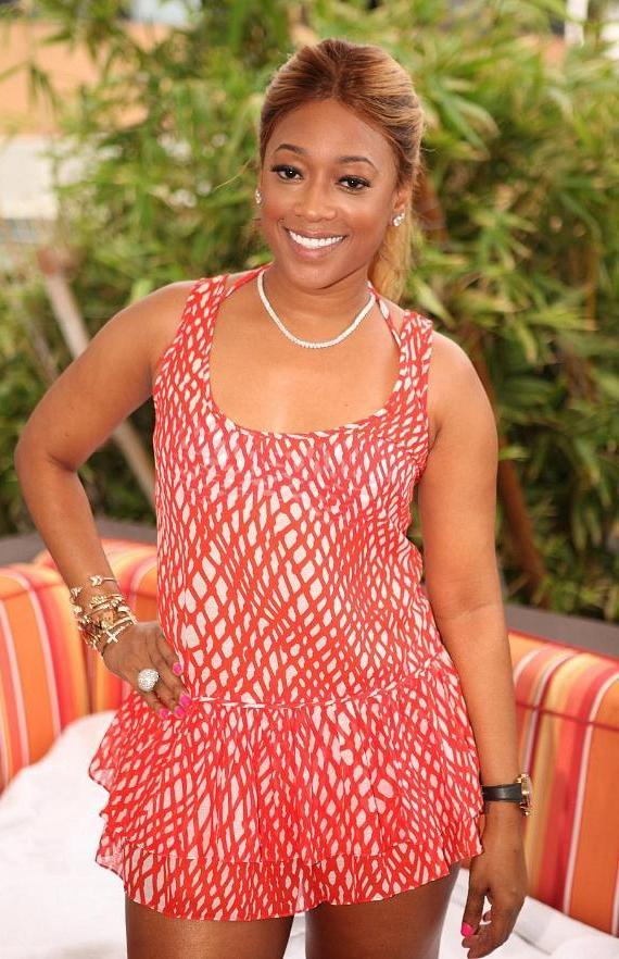 Gorgeous rapper, Trina, hangs out at French Montana's VIP booth at Palms Pool