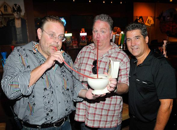 Tuttleman and Green with Kevin Burke and the famous Rock & Rita's toilet bowl souvenir cup
