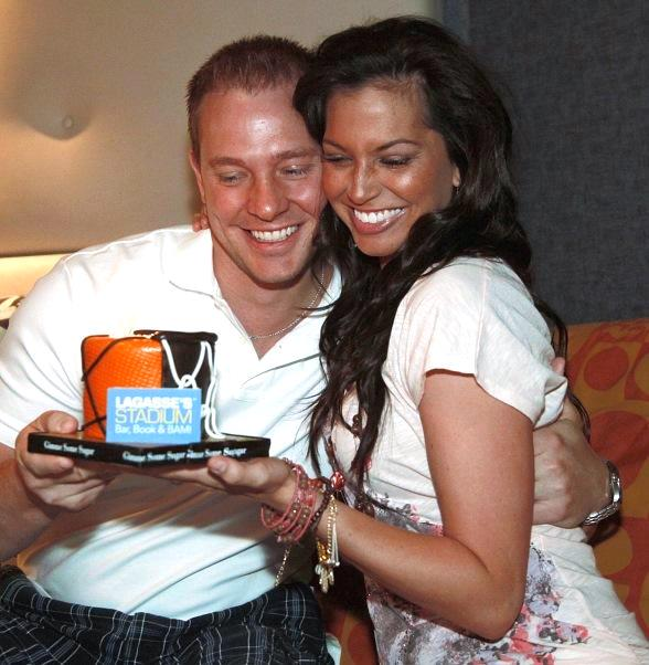 Tye and Melissa hugging with cake at Lagasse Stadium in The Palazzo