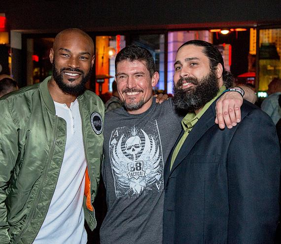 "Tyson Beckford and Kris ""Tanto"" Paronto posing with fans at Hyde Bellagio during Outdoor Tradeshow after-party"