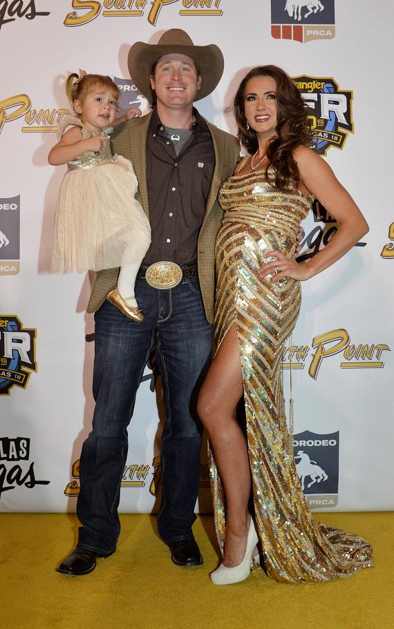 Tyson Durfey, WNFR tie down roper, and wife, Shea Fisher, Australian-born country singer, and daughter, Praise Royal Durfey