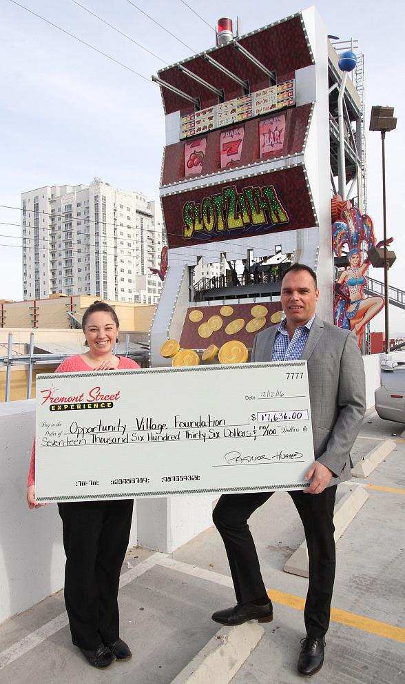 Fremont Street Experience Presents Opportunity Village with a Check for $17,636 Raised at SlotZilla Charity Challenge