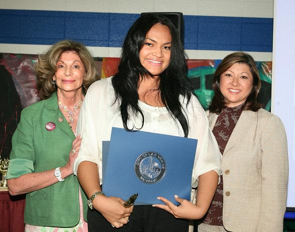 Nevada Congresswoman Shelley Berkeley (left) and Henderson Councilwoman Gerri Schroder (right) acknowledge AmeriCorps member Meagan HoChing's (center) volunteer achievements in the community