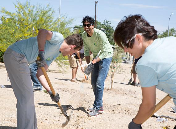 Venetian and Palazzo team members dig an irrigation trench at Freedom Park