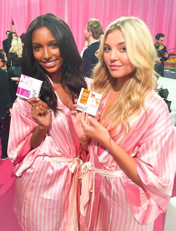 Victoria's Secret Angels Jasmine Tooks and Rachel Hilbert enjoying HEXX chocolate backstage at the 2015 Victoria's Secret Fashion Show
