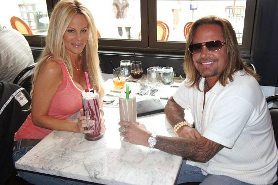 Vince Neil and Lia Gerardini with milkshakes at Sugar Factory American Brasserie
