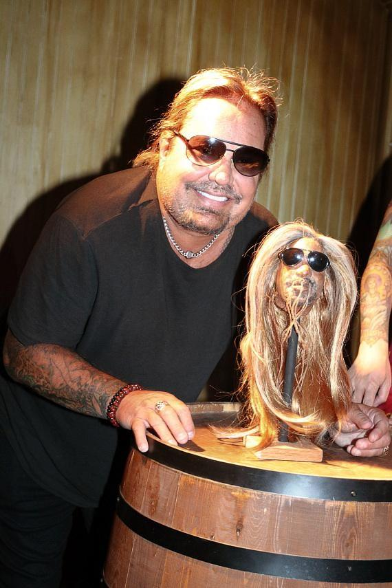 Vince Neil with shrunken head at The Golden Tiki