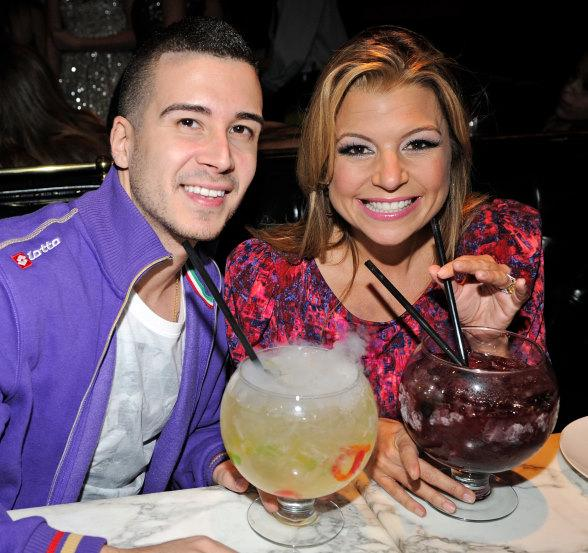 Vinny Guadagnino and Dana Wilkey with Sugar Factory goblets at Sugar Factory
