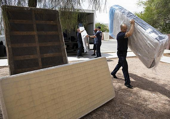 Walker Furniture carrying new mattresses past old ones