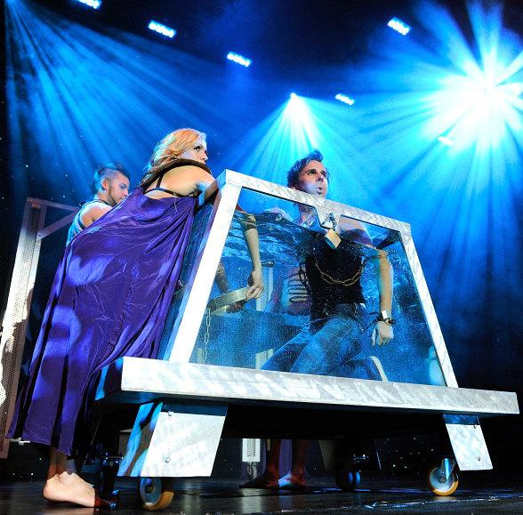 "Jan Rouven pays tribute to Harry Houdini as he prepares to ""dive-in"" to the famous Water Tank illusion onstage at his show ILLUSIONS in Las Vegas"