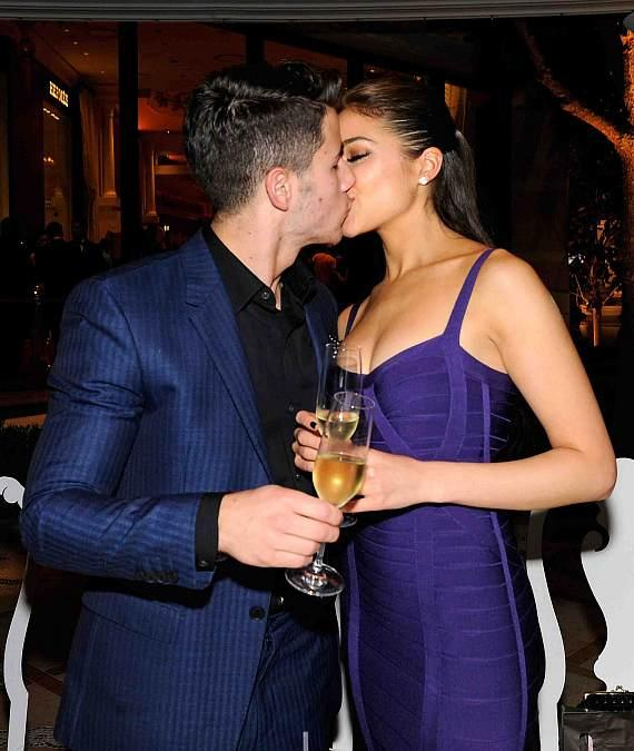 Nick Jonas kisses girlfriend Olivia Culpo