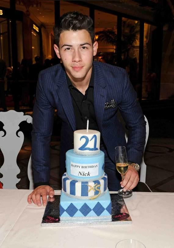 Nick Jonas with cake at Botero